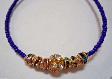 Rakhi/Bracelet in Multi Color Crystal Gold Tone Knotted With Beads By Teknowear