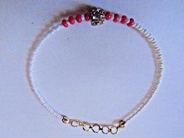 Fuchsia Gold Crystal Rakhi/Bracelet With Ivory Beads By Teknowear