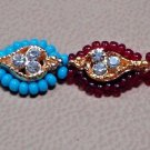 Rakhi in Dual Colored Turq & Ruby Red Beads & Threads With Crystals By Teknowear