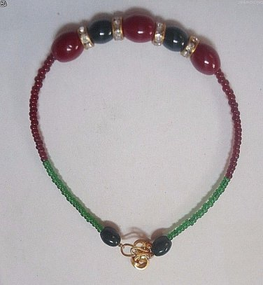 Ruby/Emerald Rakhi/Bracelet With Clear Crystal Knotted With Two Color Beads