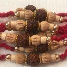 Rudraksha Rakhi With Turmeric & Basil Beads by Teknowear