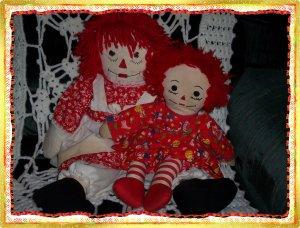 Two Raggedy Ann Dolls