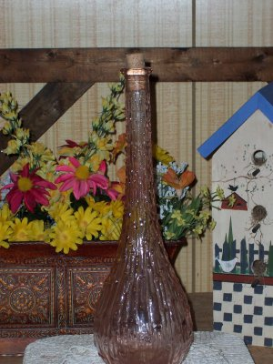 Old Bottle with Dripping Candle Look