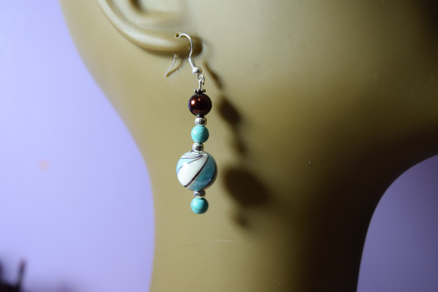 marble shaped  blue and white swirl w/ bronze bead