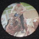 Cowboy working a cow, badge, pin  H 0012