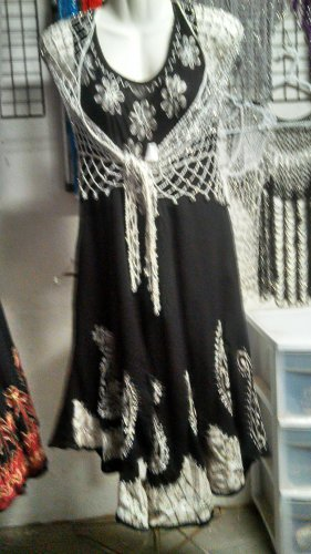 Crochet beaded shawl has silver beads and is great for the formal wordrobes