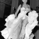 Josephine Baker dancing energetically.  - 8x10 photo
