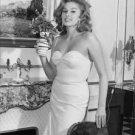 Sylvia Lopez posing with vase of flowers. - 8x10 photo