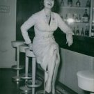 Rhonda Fleming sitting at bar. 1955. - 8x10 photo