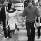 Olivia Hussey and Leonard Whiting walking. - 8x10 photo