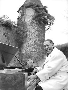 Duke Ellington playing piano and smiling.  - 8x10 photo