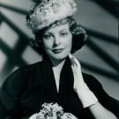 Arlene Dahl with hat and flowers. - 8x10 photo