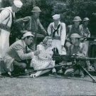 Anne Shirley and James Craig taking lesson for operating M2 Browning machine gun