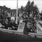 John F. Kennedy in a car with men. - 8x10 photo