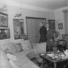 Josephine Baker in house with man, watching painting. - 8x10 photo