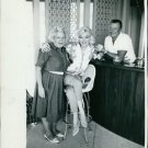 Marilyn Monroe with old woman and man. - 8x10 photo