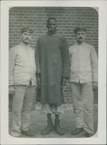 Soldiers posing with a prisoner. - 8x10 photo