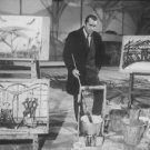Bernard Buffet with his paintings.  - 8x10 photo