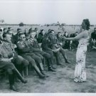 Woman performing for German officers and soldiers. - 8x10 photo