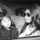 Sophia Loren in car with a little girl.  - 8x10 photo