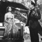 Elizabeth Taylor with Joseph L. Mankiewicz. - 8x10 photo