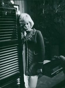 Sylvie Vartan standing. - 8x10 photo