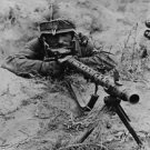 A soldier with gun ready to shoot. - 8x10 photo