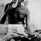 Mahatma Gandhi drinking - 8x10 photo