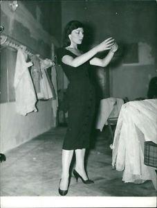 Juliette Greco, in black dress, standing.  - 8x10 photo