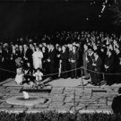 People paying tribute in night.  - 8x10 photo