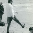 Richard Burton at beach. - 8x10 photo