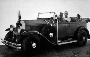 Mahatma Gandhi travelling by car.  - 8x10 photo