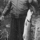 Jussi Björling holding a fish. - 8x10 photo