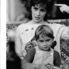 Gina Lollobrigida with child  pointing. - 8x10 photo