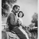 Clark Gable riding horse with a child.  - 8x10 photo