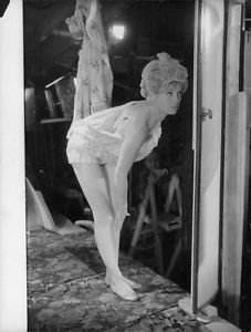 Brigitte Bardot bending. - 8x10 photo