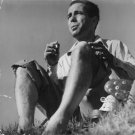 Humphrey Bogart smoking. - 8x10 photo