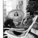 Dirk Bogarde and Capucine laughing. - 8x10 photo