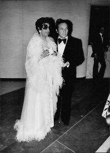 Josephine Baker wearing sunglasses with man.  - 8x10 photo