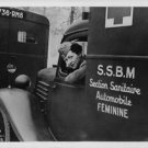 World War II. French woman driving an ambulance - 8x10 photo