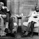 Mahatma Gandhi having teatime with Lord Mountbatten. - 8x10 photo