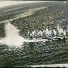 U.S. escort carrier blasts submarine packs. - 8x10 photo