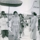 Queen Sirikit smiles as she arrived in the airport. - 8x10 photo