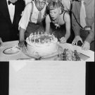 Lucille Ball celebrating. - 8x10 photo
