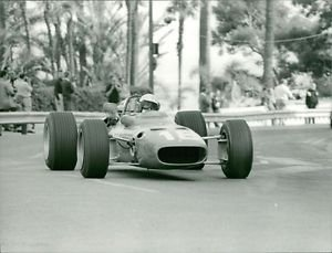Lorenzo Bandini racing. - 8x10 photo
