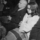 Charlie Chaplin and Oona O'Neill sitting.  - 8x10 photo