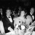 Ludmilla Tcherina sitting with Salvador Dali in a party. - 8x10 photo
