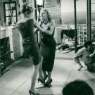 Brigitte Bardot fighting with a woman.  - 8x10 photo