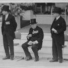 Winston Churchill sitting. - 8x10 photo