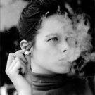 Geraldine Chaplin smoking. - 8x10 photo